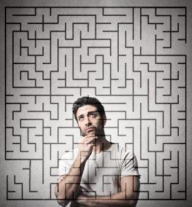 Photo of a man behind a maze