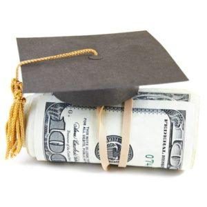 A hundred dollar bill rolled up with a grad cap on top
