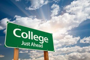 "A street sign that says "" College Just Ahead"""