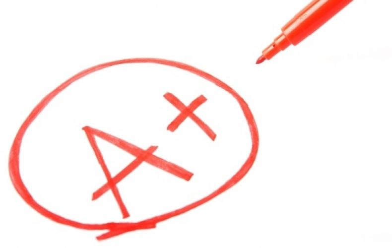 An A+ in a circle written in a red pen