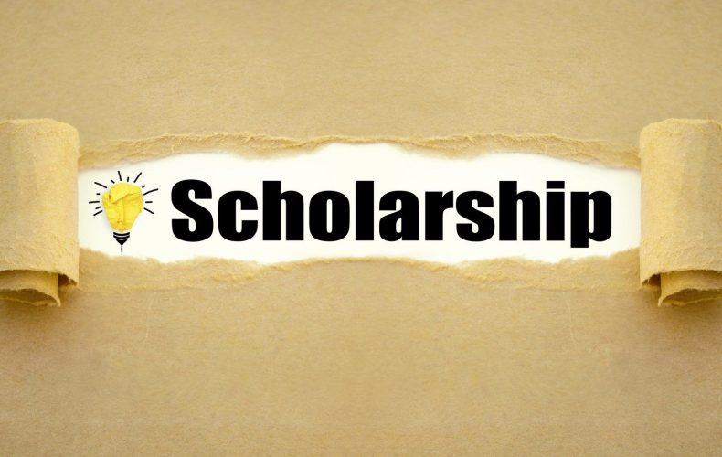 The word scholarship written under a piece of paper