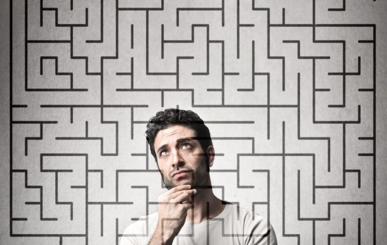 Photo of a man behind a maze
