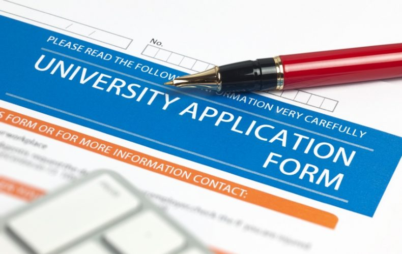 college application with pen
