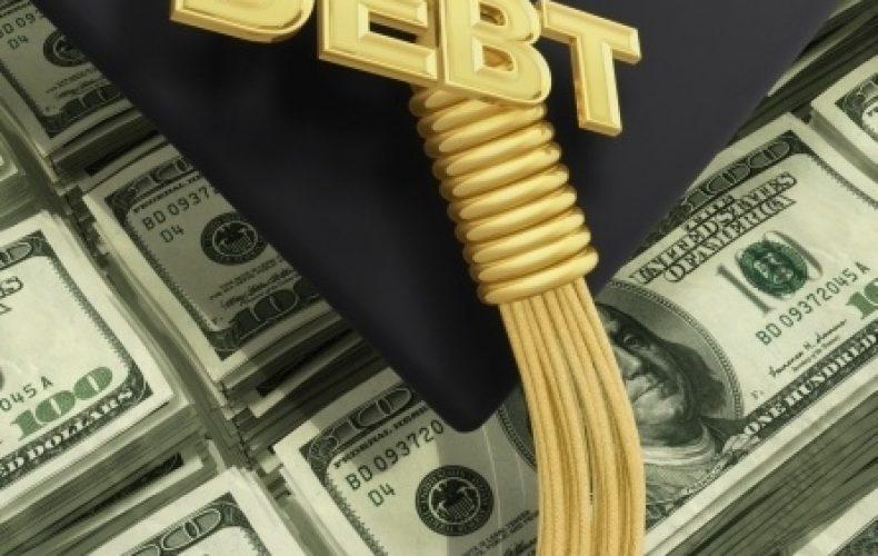 a tassel for graduation reading debt